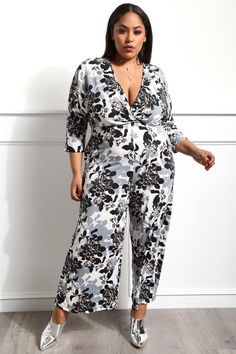469da55fa09 Look amazing for the night with this feminine plus size jumpsuit! Features  floral prints on