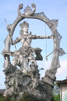 Arjuna statue at an intersection just outside Ubud, Bali, Indonesia