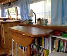 This may be my favorite bus yet. Love the way the table folds up. Small House Living, Bus Living, Small House Plans, Home And Living, Tiny House Swoon, Tiny House On Wheels, School Bus House, Fold Out Table, Tiny House Movement