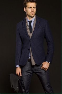 Shop this look for $258:  http://lookastic.com/men/looks/pocket-square-and-blazer-and-scarf-and-dress-shirt-and-tie-and-belt-and-jeans-and-briefcase/467  — Black Polka Dot Pocket Square  — Navy Blazer  — Grey Scarf  — Blue Dress Shirt  — Black Tie  — Brown Leather Belt  — Navy Jeans  — Black Leather Briefcase