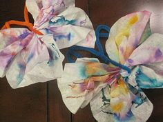 Rainy day fun... spring decorations!  Butterfly coffee filters.