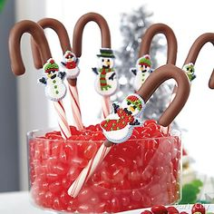 Sweeten up your Christmas treats! Dip candy canes into Candy Melts® & add cute sugar decorations to finish off these adorable confections!North Pole Friends Christmas Treats Ideas - Party City