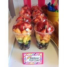 Rainbow fruit cups at a Sweet Shoppe Birthday Party!  See more party ideas at CatchMyParty.com!