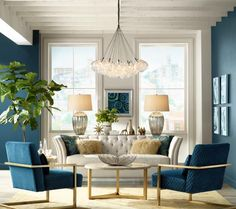 From paired oversized lamps to matching chairs, stunning symmetry frames a beautiful sitting area. Sleek lines, bold colors and metallic accents are hallmarks of style with cosmopolitan appeal.
