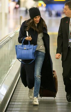 Meghan Markle from How to Dress Like Meghan Markle  The Suits star has a pretty digestible wardrobe. By that we mean, no matter your personal style, you're going to love everything she's worn thus far.Take her airport outfit, for example. She's mixed ripped jeans, a wool coat and classic beanie with higher-end things like that Mulberry bag and cashmere sweater. She's got a royal-worthy closet that's deserving of your full attention.Prepare to be inspired.
