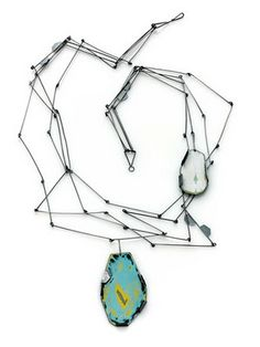 Amy Taven........Connie Fox: The turquoise pendant is the focal point.