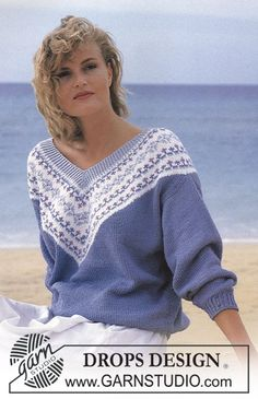 """DROPS jumper with flower pattern border on V-neck in """"Muskat"""". - Free pattern by DROPS Design"""