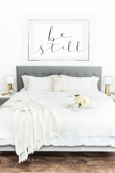 white bedroom which exudes calming vibes. Give it an added glam with gold lampshades and large wall frame.