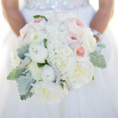 White and blush-pink peonies and garden roses were accented with dusty miller