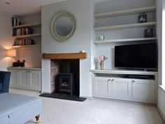 The room after with bespoke built in cabinetry hand painted in Little Greene Sla. - The room after with bespoke built in cabinetry hand painted in Little Greene Slaked Lime Dark - Alcove Ideas Living Room, Living Room Shelves, Living Room Storage, Living Room With Fireplace, New Living Room, Built In Cupboards Living Room, Living Room With Stove, Living Room With Stairs, Small Living