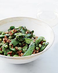Learn to make this superflavorful and easy stir-fried pork with snap peas and green peas at Food & Wine.