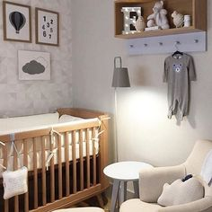 Nursery with geometric wallpaper by Eco.