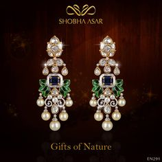 A #uniquely crafted pair of #earrings in 18kt yellow gold, inspired by #peacock colours with a #fusion look using uncut and round brilliant cut #diamonds and fresh-water #pearls #ShobhaAsar #ShobhaAsarJewels #ShobhaAsarJewellery