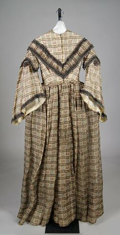Printed brown cotton afternoon dress with ruched silk trim, American, 1855-1860.