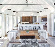 Open plan living room and kitchen by trinettereed | Stocksy United