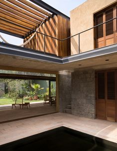 Rozana Montiel pairs wood and stone for garden home outside Mexico City