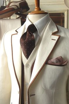 The waistcoat- invert colours and swap the brown for navy