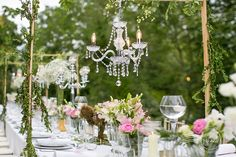 """Outdoor-wedding-table-with-chandeliers"""