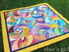 Radiant Suns #quilt #swirls.  Has link to curved templates.  Possibility for first curved piecing project?