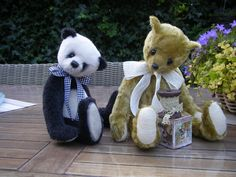 Balou the Panda and Oldie the vintage bear.