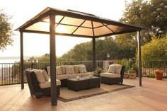 STC 10x13 Madrid Square Gazebo by STC. $1612.79. Offering longevity and unmatched, year-round beauty, this strong gazebo will bring your patio set or spa area to life.. GZ620H Features: -Gazebo.-Material: Aluminum and steel frame.-Can be anchored to concrete or a wood deck.-Ground stakes provided.-0.4cm Polycarbonate roof.-Heavy gauge extruded aluminum.-Easy to assemble. Assembly Instructions: -Assembly required. Warranty: -6 Years warranty on the top.-10 Years warranty on the frame.