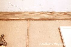 burlap covered walls, with twine to cover the seams.