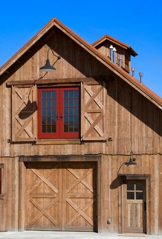 Loving the black barn light goosenecks on this barn. Barnlight Originals features great outdoor  lighting solutions.