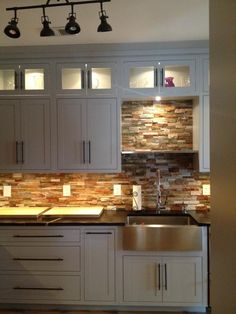"""Stone backsplash & light in supper cabinets with glass doors Lacey's """"Cook's Delight"""" Kitchen   Apartment Therapy"""