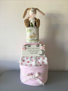 Adorable baby girl nappy cake including lots of yummy essentials £40