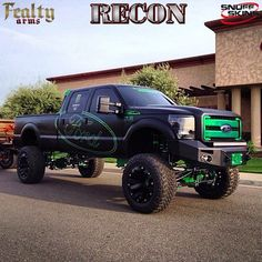 Black and green lifted Ford with custom bumper and lights. Now my son Ford wants one!