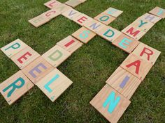 "Expand your vocabulary with this outdoor lawn word game. Cut squares from sheets of wood that are a half-inch thick. Sand down the edges of the ""tiles,"" paint on the letters and numbers, and get ready for a good time! Get the tutorial at Consider the Peel.   - CountryLiving.com"