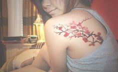 back of shoulder/red ink/branches/blossom/artwork/pretty