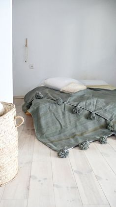 Image of  Moroccan POM POM Wool Blanket Greenish Gray