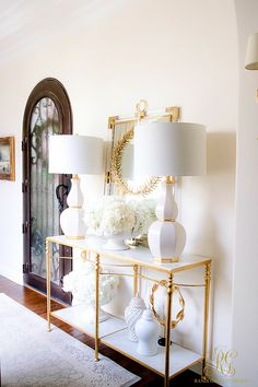 Entry + Hallway with marble and gold console table, white gourd lamps, white ginger jars, white hydrangeas and gold and lucite mirror how to hide lamp cords- Randi Garrett Design Spring Home, Autumn Home, Entryway Decor, Entryway Tables, Console Tables, Decor Interior Design, Interior Decorating, Entry Hallway, Foyer Decorating