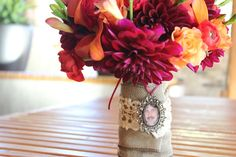 A beautiful fall Bridal bouquet using a photo of a loved one as part of the wrap.  Bouquet designed by Eastern Floral.
