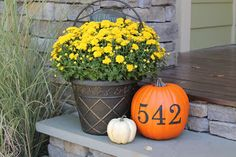 Mums and pumpkins-the perfect fall front porch decorations