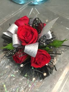 Wristlet corsage with red spray roses, black and silver ribbon, clear rhinestones and black accents. #prom #corsage #wristlet #flowers #theflowershopfairoaks