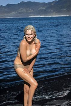 """Nevada. US actress Marilyn MONROE. Marilyn after a swim in Pyramid Lake, Nevada. From a scene in """"The Misfits."""" 1960. by Eve Arnold"""