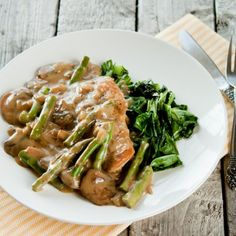 Healthy Pan Fried Chicken with Creamy Mushroom Asparagus Sauce.
