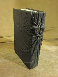 Grichels leather safe book - black with bronze speckled slit pupil reptile eyes.