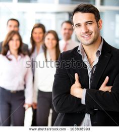 stock photo : Successful businessman at the office leading a group