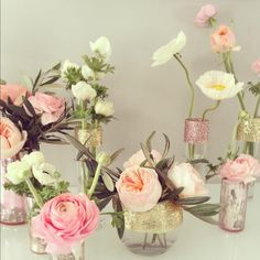 Glitter, Mercury Glass, Pinks, Peaches and Golds were the theme of this bridal shower. Garden Roses, Ranunculus, Poppies, Tulips and Olive Branches were used in these fun arrangements designed in glittered and mercury glass vases.