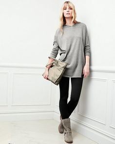 The slouchy silhouette of our tunic is a fabulously flattering way to anchor any slim bottom in your closet, leggings to jeans. The sumptuous silk/cotton fabrication gives the sweater great drape. A hood and hidden kangaroo pocket underscore the casual mood.