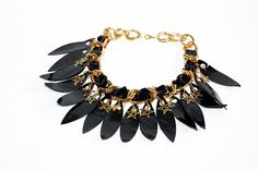 Leather patent black necklace on gold metal chain. by Vittro