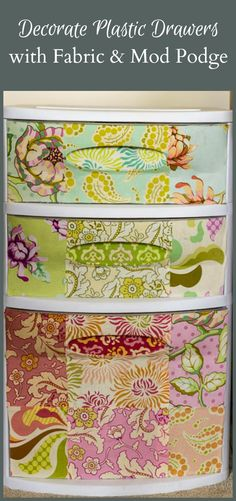 How to Create Beautiful Plastic Drawers with Mod Podge and Fabric - - How to Create Beautiful Plastic Drawers with Mod Podge and Fabric Crafts Learn how to transform plain plastic drawers from ordinary to extraordinary with mod podge and fabric. Decorate Plastic Drawers, Plastic Storage Drawers, Fabric Storage Bins, Diy Drawers, Fabric Boxes, Fabric Basket, Storage Units, Storage Solutions, Dorm Storage