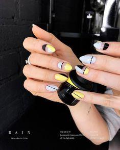 Baby blue, yellow and black nail art.