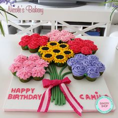 "The most adorable and colorful cake ever!! Cupcake cake / Pull apart cupcake. Perfect idea for any celebration, there is no cutting involved and they are the perfect size. Beautiful flowers arrangement for a lovely girl, ""Camila"". Delicious Vanilla Cupcakes, filled with Nutella and decorated with Almond Buttercream Frosting"