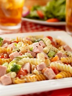 Barbara's Pasta Salad-  Made this with a few of my own twists. I used ham instead of chicken and Lonzerattis Sweet Italian Dressing instead of the dressing in the recipe. The boys LOVED it!!!! I will be making this again.
