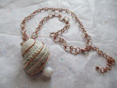 Bronze Wire Wrapped Sea Shell Necklace by AdmiredMiranda on Etsy, $13.60: https://www.etsy.com/listing/179500646/bronze-wire-wrapped-sea-shell-necklace