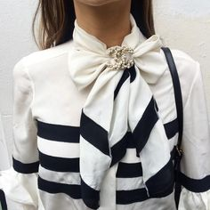 """""""Current obsession: brooches  Three ways to wear starts with neck scarves or, in this case, a blouse with bow attached 